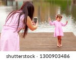 happy mother with a child take...   Shutterstock . vector #1300903486
