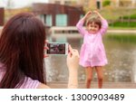happy mother with a child take...   Shutterstock . vector #1300903489