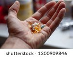 a sick man holds in his hand... | Shutterstock . vector #1300909846