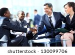 Stock photo business people shaking hands finishing up a meeting 130099706