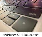 macro view of a laptop keyboard | Shutterstock . vector #1301000809