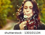 girl blowing on white dandelion ... | Shutterstock . vector #130101134
