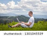 man with laptop sitting on... | Shutterstock . vector #1301045539