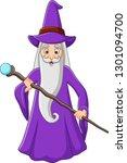 Cartoon Old Wizard Holding...