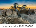 Two Excavators Moving Stone An...