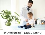 male doctor working with cute... | Shutterstock . vector #1301242540