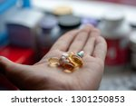 a sick man holds in his hand... | Shutterstock . vector #1301250853