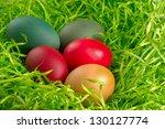 easter eggs an green grass - stock photo