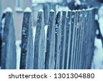 photo of a wooden fence with...   Shutterstock . vector #1301304880