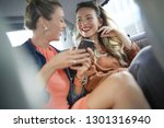 two attractive friends talking... | Shutterstock . vector #1301316940