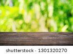 empty dark wooden table in... | Shutterstock . vector #1301320270