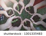 multicultural hands of adult... | Shutterstock . vector #1301335483