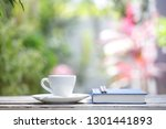white coffee cup with plant and ... | Shutterstock . vector #1301441893