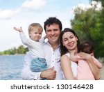 happy young family with two... | Shutterstock . vector #130146428