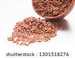 raw brown rice scattered out of ... | Shutterstock . vector #1301518276