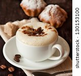 Cup of cappuccino and cake on a dark background close up. - stock photo