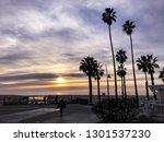 sunset over the pacific ocean... | Shutterstock . vector #1301537230