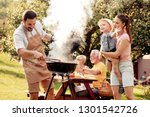 family having a barbecue party... | Shutterstock . vector #1301542726