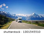 Two white caravan cars on the way in New Zealand. Traveling concept. Camper vans.  - stock photo