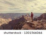 traveler on cliff mountains... | Shutterstock . vector #1301566066