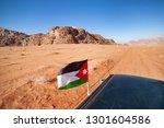 jordan traveling by red desert... | Shutterstock . vector #1301604586