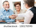 senior couple smiling while... | Shutterstock . vector #130170590