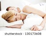 portrait of couple sleeping in... | Shutterstock . vector #130173608