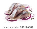 Stock photo isolated pieces of salt fillet herring with onion 130176689
