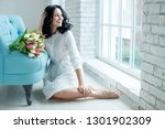 woman with spring flowers | Shutterstock . vector #1301902309