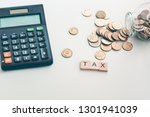 "wooden word ""tax""  calculator ... | Shutterstock . vector #1301941039"