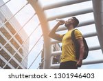 yellow sporty guy is drinking...   Shutterstock . vector #1301946403