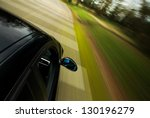 side view of black car driving... | Shutterstock . vector #130196279