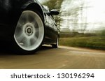 front side view of black car. | Shutterstock . vector #130196294