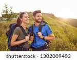happy couple of tourists ... | Shutterstock . vector #1302009403