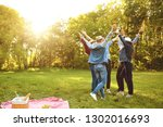 group of happy friends on green ... | Shutterstock . vector #1302016693