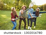 friends have fun playing in the ... | Shutterstock . vector #1302016780