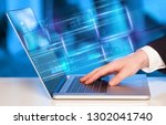 hand using laptop with database ... | Shutterstock . vector #1302041740