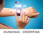 female hand with smartwatch and ... | Shutterstock . vector #1302045166