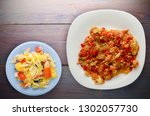 stewed tomatoes with onions in... | Shutterstock . vector #1302057730