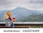 woman drinking coffee with the... | Shutterstock . vector #1302076309