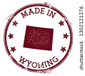 made in wyoming stamp. grunge... | Shutterstock .eps vector #1302121276