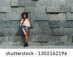 a beautiful cheerful african... | Shutterstock . vector #1302162196