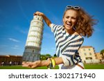 smiling stylish woman in... | Shutterstock . vector #1302171940