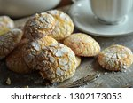 almonds crinkles on a wooden... | Shutterstock . vector #1302173053