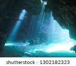 diving inside tunnels with...   Shutterstock . vector #1302182323