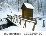 Wooden Bridge And Cabin In A...