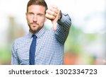handsome business man wearing... | Shutterstock . vector #1302334723