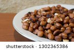 roasted peanuts snack in white... | Shutterstock . vector #1302365386