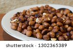 roasted peanuts snack in white... | Shutterstock . vector #1302365389
