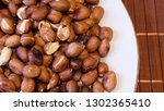 roasted peanuts snack in white... | Shutterstock . vector #1302365410
